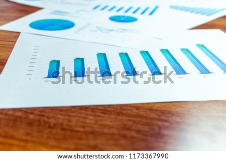Charts and graphs are placed on the desks, data, and statistical performance of the company in the past year. #1173367990