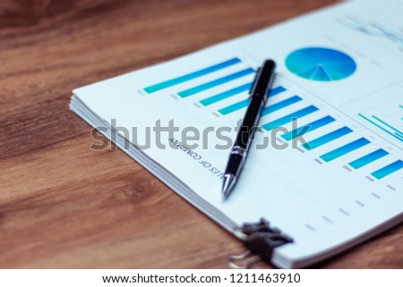Charts and graphs are placed on the desks, data, and statistical performance of the company in the past year. #1211463910