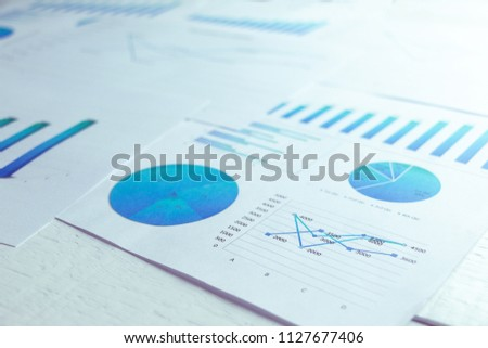 Charts and graphs,documents are placed on the desks, data, and statistical performance On the wood table #1127677406