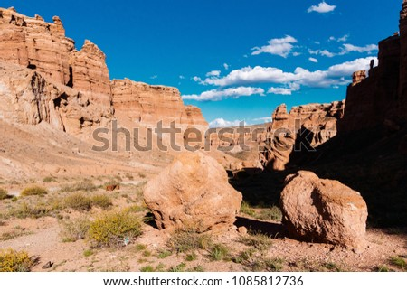 Charyn Canyon bottom view - geological formation consists of amazing big red sand stone. Charyn National Park. Kazakhstan. #1085812736