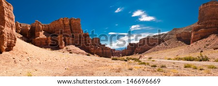 Charyn canyon under blue sky. State National Paleontology Park in Kazakhstan. Three images panorama #146696669