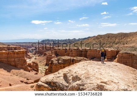 Charyn National Park Sharyn Canyon Breathtaking Picturesque High Angle View of Rock Valley of Castles while a Boy is Making a Picture