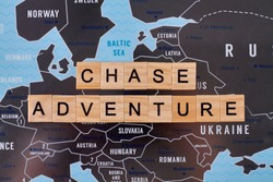 Chase adventure slogan on a map. Abstract advertising slogan for travel agency.