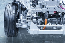 Chassis of the electric, hybrid car with powertrain. Car maintenance. Blue toned.