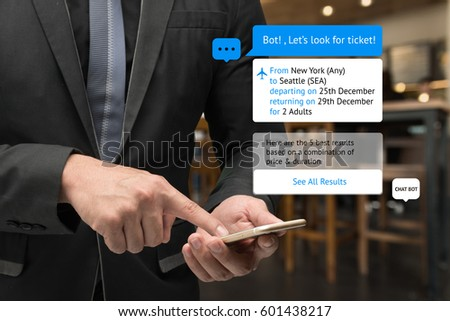 Chat bot and future marketing concept . Business man hand holding smartphone look for ticket and popup out smart phone screen with automatic chatbot message screen , coffee shop background #601438217