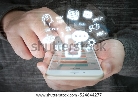 Chat bot and future marketing concept , chatbot connect icons with hand holding mobile phone and icons popup out smartphone screen. #524844277