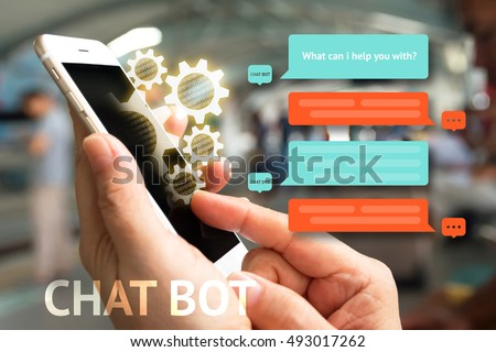 Chat bot and future marketing concept , Chatbot icon , Hand holding mobile phone and gear popup out mobile screen with automatic message screen with abstract background #493017262