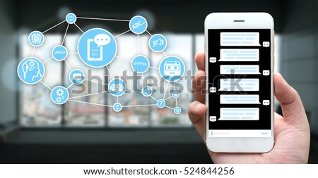 Chat bot and future marketing concept. Hand holding mobile phone , Chatbot application and infographic with building and window background #524844256