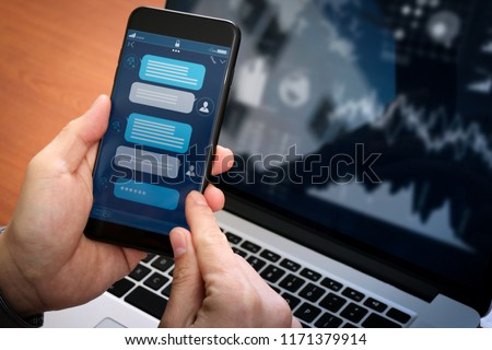 Chatbot conversation with smartphone screen app interface and artificial intelligence technology processing virtual assistant with customer support information, business hand holding mobile phone.