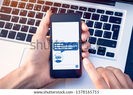 Chatbot with artificial intelligence technology (AI) internet virtual assistant on smartphone screen, online customer support website or social media network, information about products or services