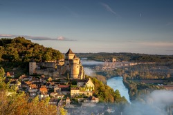 Chateau Castlenaud at sunrise with the Dordgne river and Chateau Beynac
