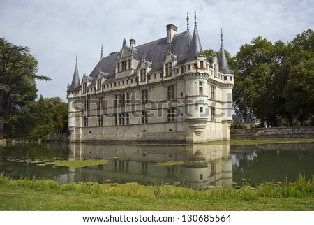 Chateau d'Azay-le-Rideau sets on an island in the middle of the Indre river. - stock photo
