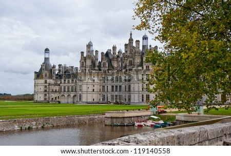 Chateau de Chambord is one of the most known castles of the Loire Valley, France. There are some unrecognizable tourists on balcony