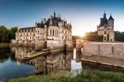 Chateau de Chenonceau at sunset, France. Castle located near the small village of Chenonceaux in Loire Valley and is a French landmark. Panoramic view of the old mansion on the River Cher in evening.