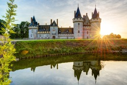 Chateau de Sully-sur-Loire at sunset, France. This castle is one of the landmarks in Loire Valley. Scenic view of nice medieval castle on a lake. Beautiful panorama of the old mansion in sun light.
