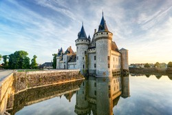 Chateau de Sully-sur-Loire in summer, France. This old castle located in the Loire Valley and is a French historical landmark. Beautiful panorama of the medieval castle with reflections in the water.