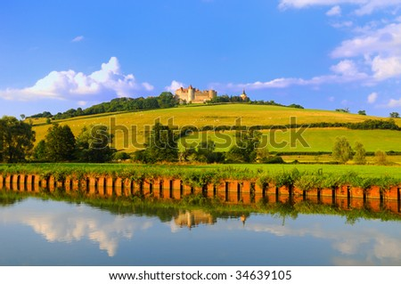 stock-photo-chateauneuf-in-burgundy-france-from-the-dijon-canal-34639105.jpg