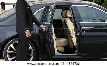 Chauffeur opening car door