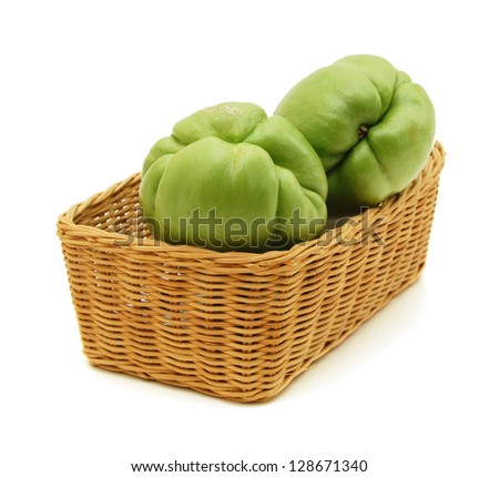 chayote chokos in basket on white background.