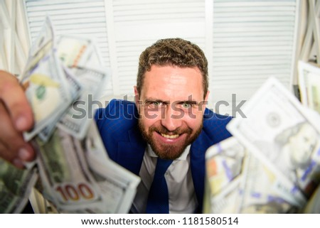 Che k out my profit this month. Earn money easy business tips. Man cheerful happy businessman with pile dollar banknotes. Profit and richness concept. Businessman formal suit hold cash dollars hands. Stock foto ©