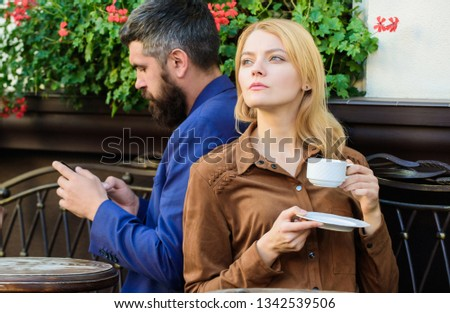 Cheat and betrayal. Family weekend. Married lovely couple relaxing together. Couple cafe terrace drink coffee. Couple in love sit cafe terrace enjoy coffee. Man secret messaging cheating on wife. #1342539506