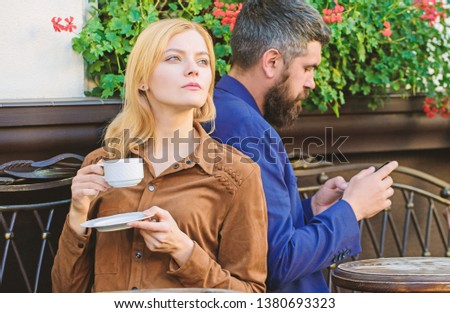 Cheat and betrayal. Family weekend. Married lovely couple relaxing together. Couple cafe terrace drink coffee. Couple in love sit cafe terrace enjoy coffee. Man secret messaging cheating on wife. #1380693323