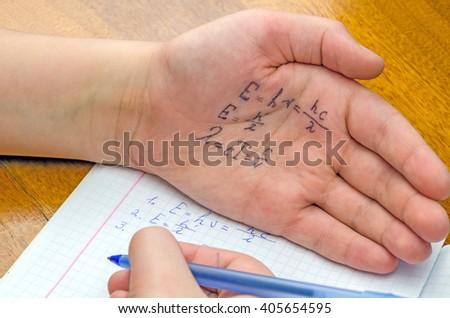 cheat sheet written in the hand a schoolboy
