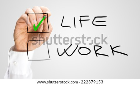 Check Box with Life and Work Choices. One Hand Checking Life Option. Isolated on Gray Background.