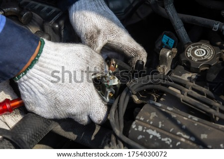 Check engine ignition system and change ignition coil. Car care service.Replacing ignition coil and spark plugs.Car mechanic fixing ignition coil on gasoline engine.