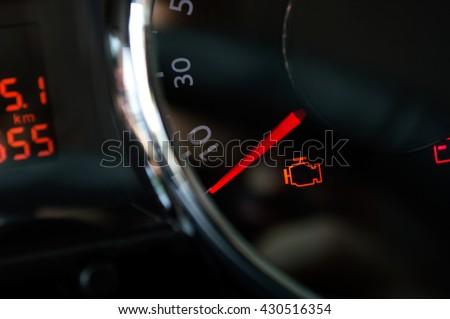 Check engine light. Car dashboard in closeup #430516354