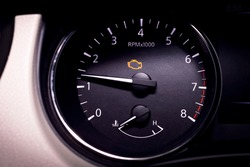 Check engine light illuminated on dashboard showing rough idle condition.