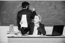 Check homework. Write down your task. Teachers working in pairs school classroom. School educator and teacher trainee with documents. Educational program. School education. Prepare for school lesson.