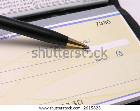 Check in checkbook with pen pointing at dollar amount