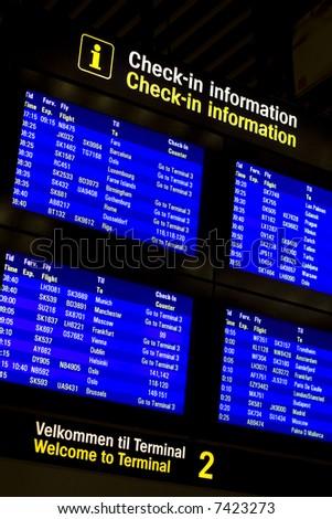 Check-in information monitors in Kastrup, airport of Copenhagen