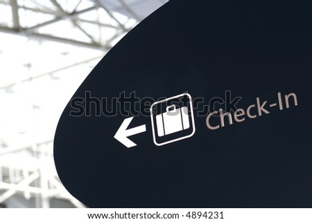 Check-in sign in international airport - blown highlights for more impact