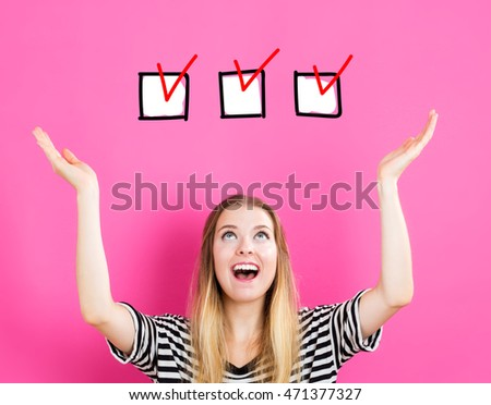 Check List concept with young woman reaching and looking upwards #471377327