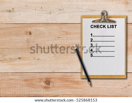 check list on paper clipboard and pencil on wood background #525868153