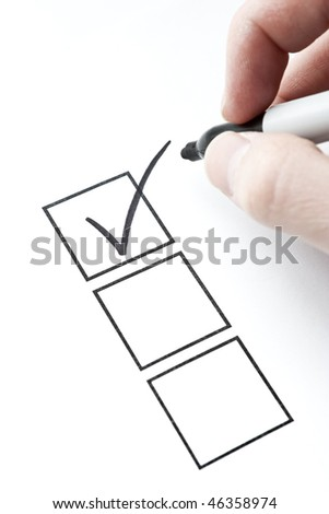 Check Mark and Box with Hand Writing. Focus on check mark in box..