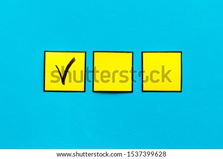 Check mark in check-box of check list on blue background top view copy space #1537399628