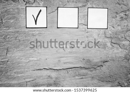 Check mark in check-box of check list on grey background top view copy space #1537399625