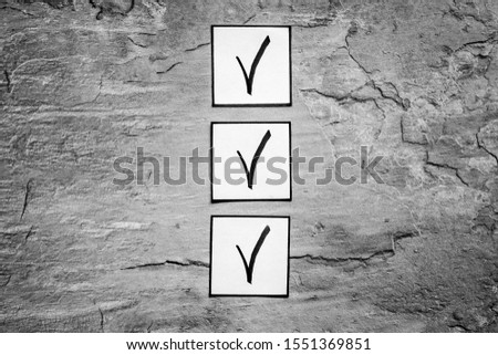 Check mark in check-box of check list on grey background top view copy space #1551369851