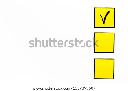 Check mark in check-box of check list on white background top view copy space #1537399607