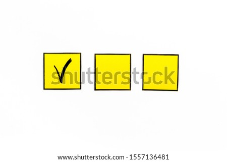 Check mark in check-box of check list on white background top view space for text #1557136481