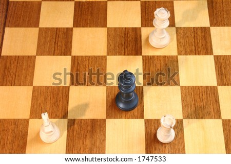 Check mate on an old wooden chess board