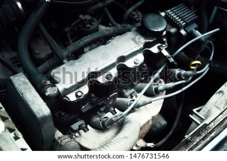 Check the status of the car engine. #1476731546