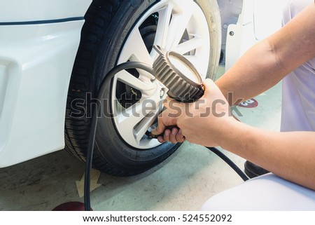 Check tire pressure With tire gauge Standards. The safe travel.
