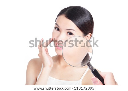 Check your health skin! beautiful asian woman with good skin and magnifying glass check it isolated on white background, concept for skincare