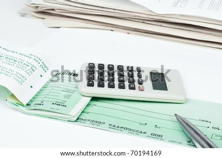 Checkbook, pen and calculator isolated on white background