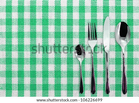 Checked cotton white and green dining cloth with silverware