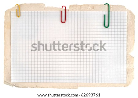 Checked notebook paper on the old grungy cardboard background